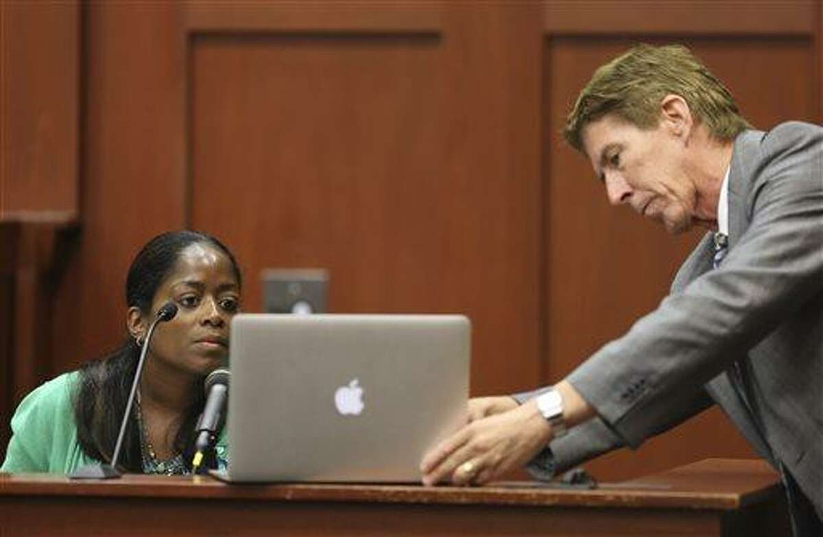 Defense attorney Mark O'Mara has state witness Selene Bahadoor read from her Facebook page while testifying during George Zimmerman's trial in Seminole circuit court in Sanford, Fla. Tuesday, June 25, 2013. Zimmerman has been charged with second-degree murder for the 2012 shooting death of Trayvon Martin. (AP Photo/Orlando Sentinel, Gary W. Green, Pool)