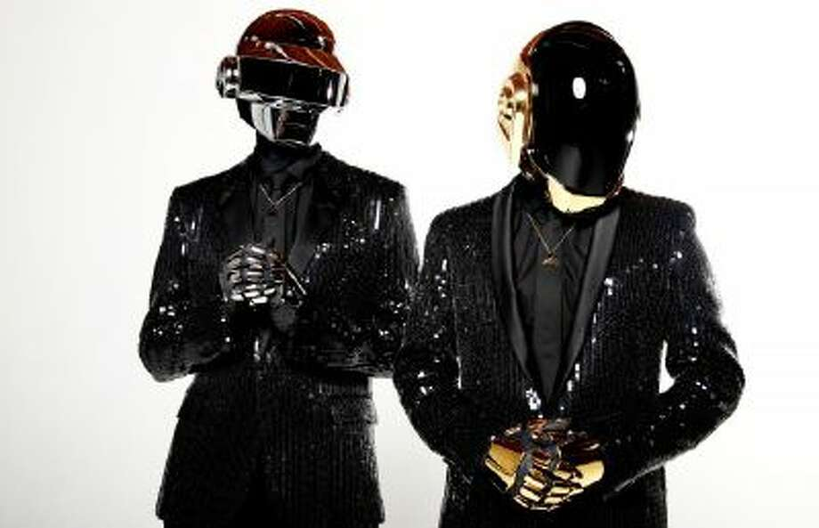 In this April 17, 2013 photo, Thomas Bangalter, left, and Guy-Manuel de Homem-Christo, from the music group, Daft Punk, pose for a portrait in Los Angeles.