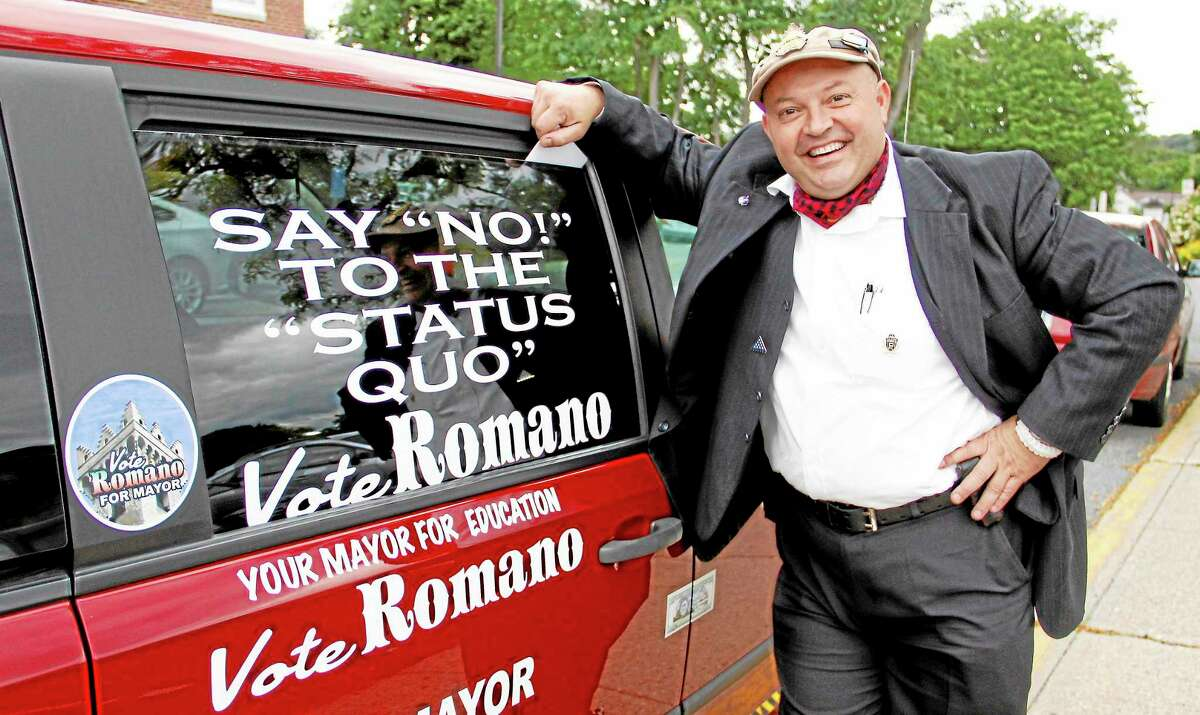 Independent mayoral candidate Giulio Romano stands in front of his van outside City Hall on Monday, Sept. 16, in Torrington.