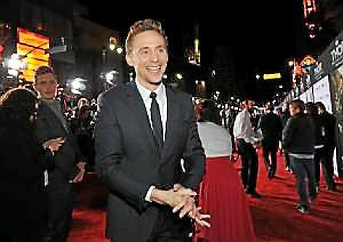 """Tom Hiddleston arrives at the U.S. premiere of """"Thor: The Dark World"""" at the El Capitan Theatre on Monday, Nov. 4, 2013, in Los Angeles."""