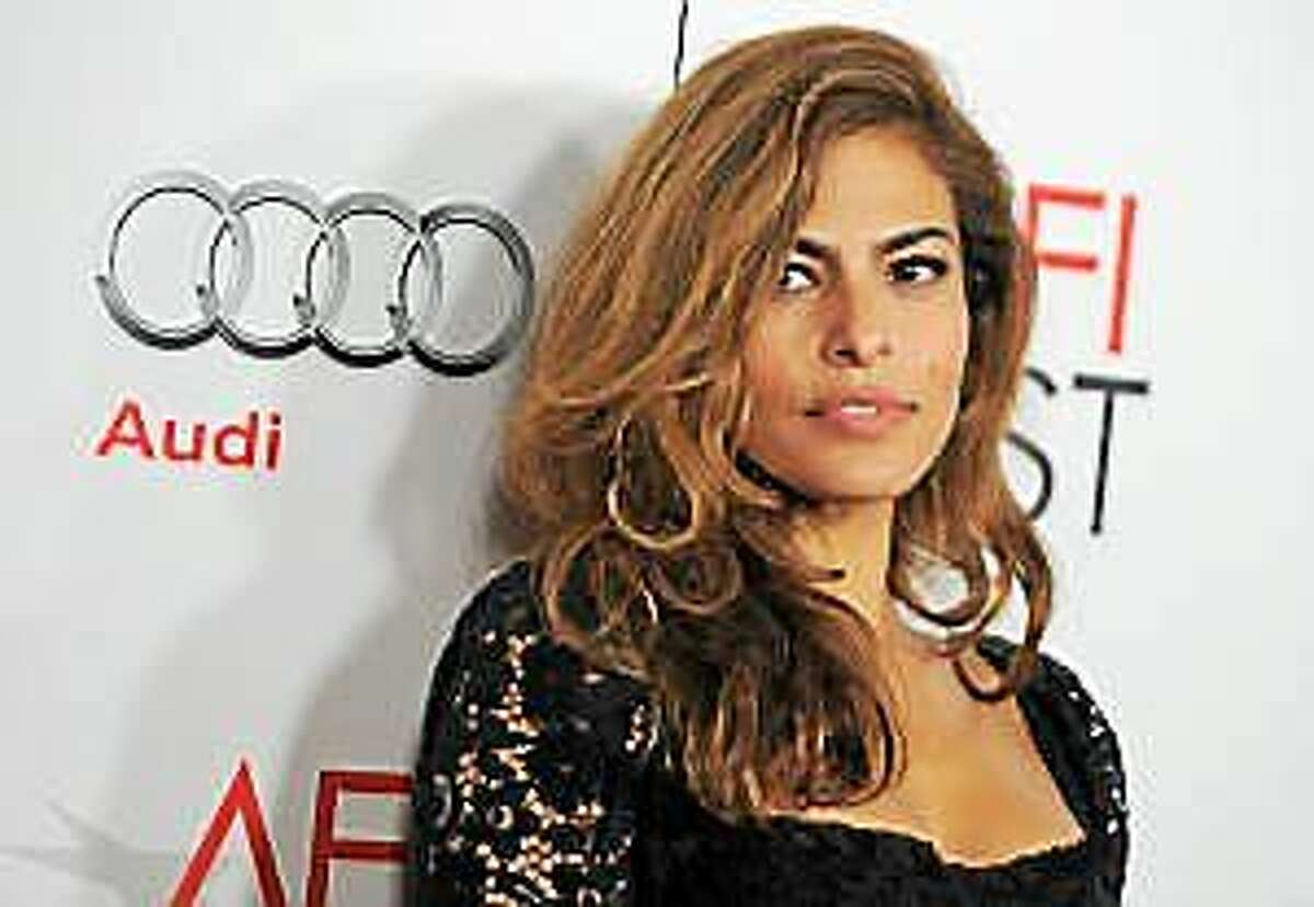 """Eva Mendes arrives at the """"On The Road"""" gala screening as part of AFI Fest on Saturday, November 3, 2012, in Los Angeles."""