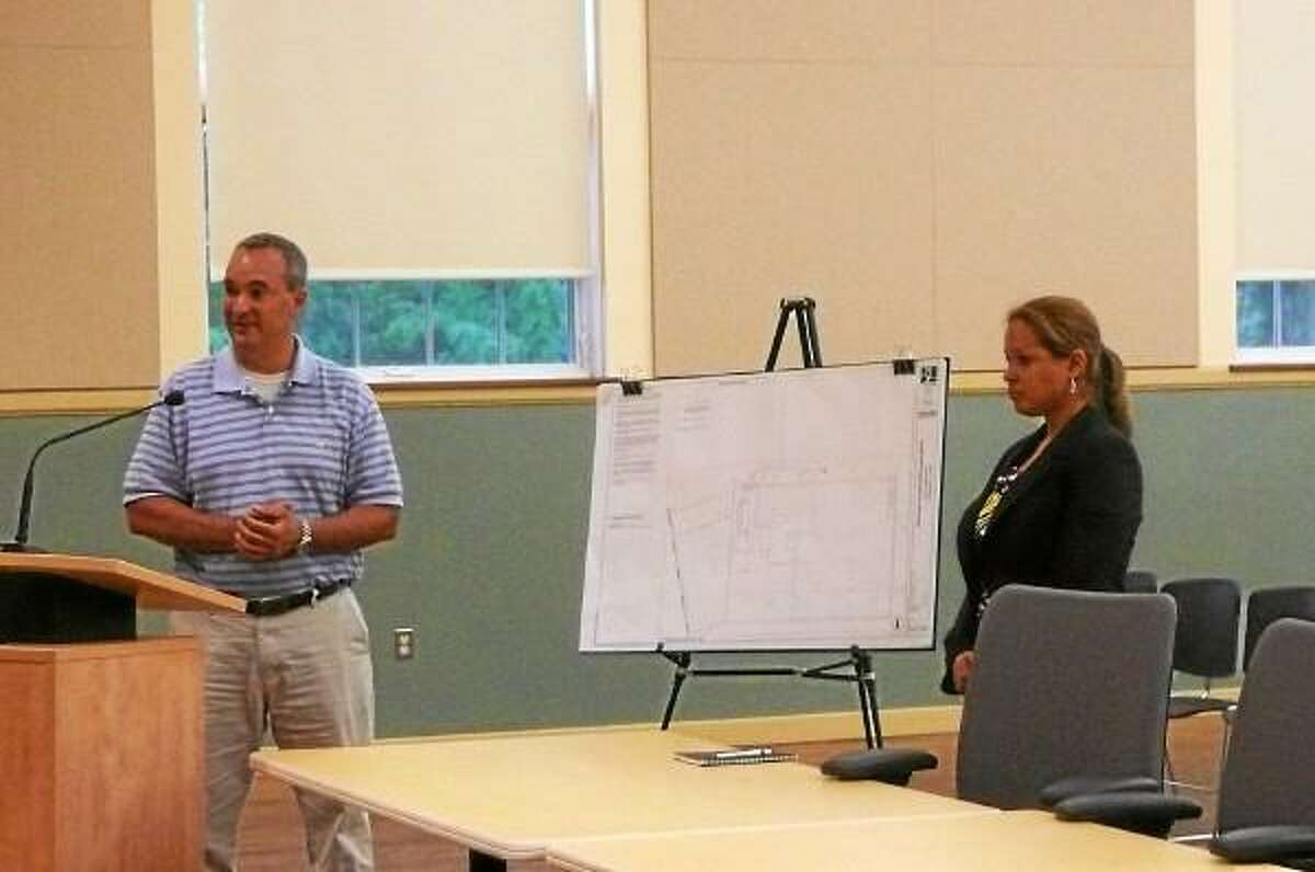 Steven Iovanna, project analyst at BL Companies, and Fernanda Alves, architectural designer, made a presentation detailing their plans Wednesday to the Torrington Planning and Zoning Commission for the signage and the façade for Joann Fabrics. (Kate Hartman-Register Citizen)
