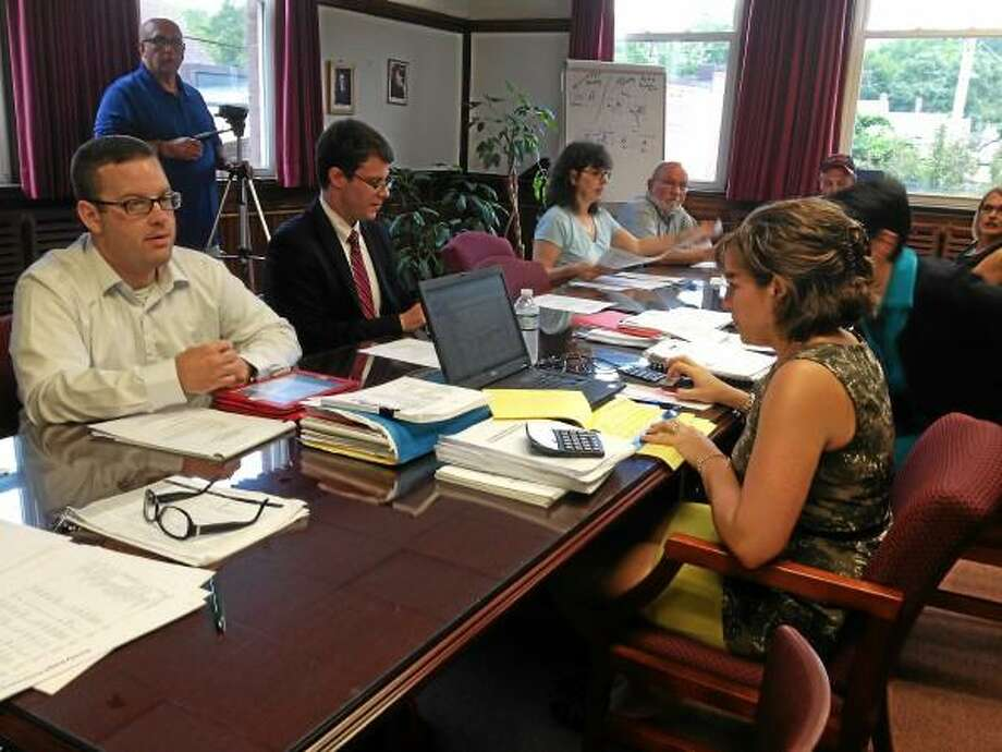 The Torrington Board of Education discusses issues at a June 26 meeting, where administrators eliminated the district's high school and middle school principal positions. (Jessica Glenza-Register Citizen)