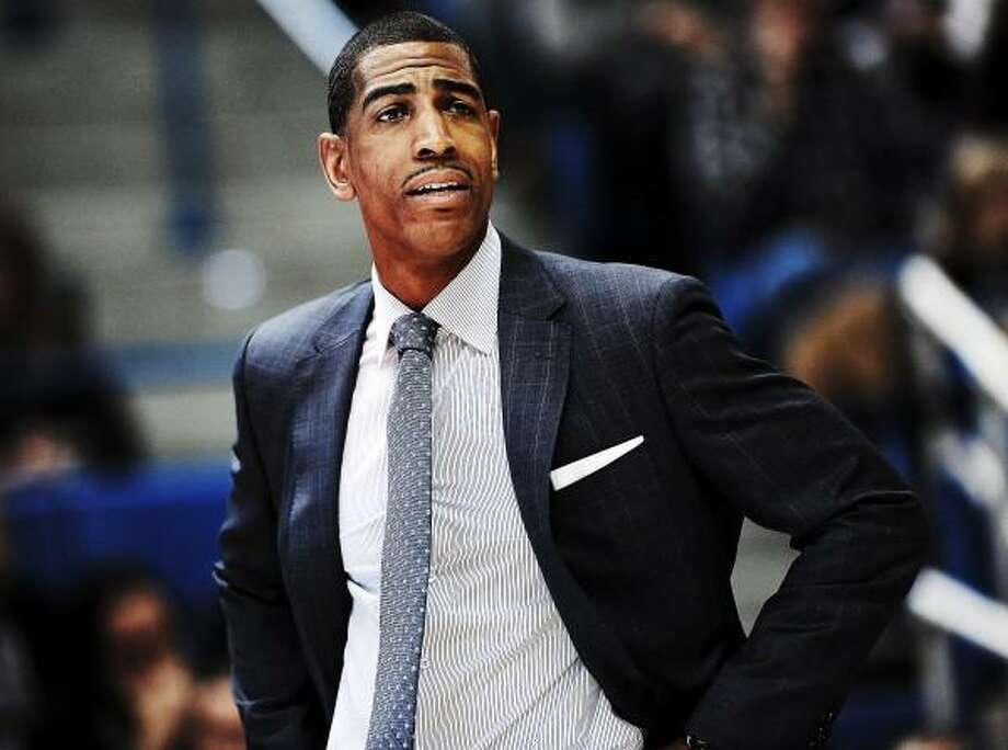 Connecticut head coach Kevin Ollie reacts during the first half of an NCAA college basketball game against Syracuse in Hartford, Conn., Wednesday, Feb. 13, 2013. Connecticut won 66-58. (AP Photo/Jessica Hill) Photo: AP / AP2013