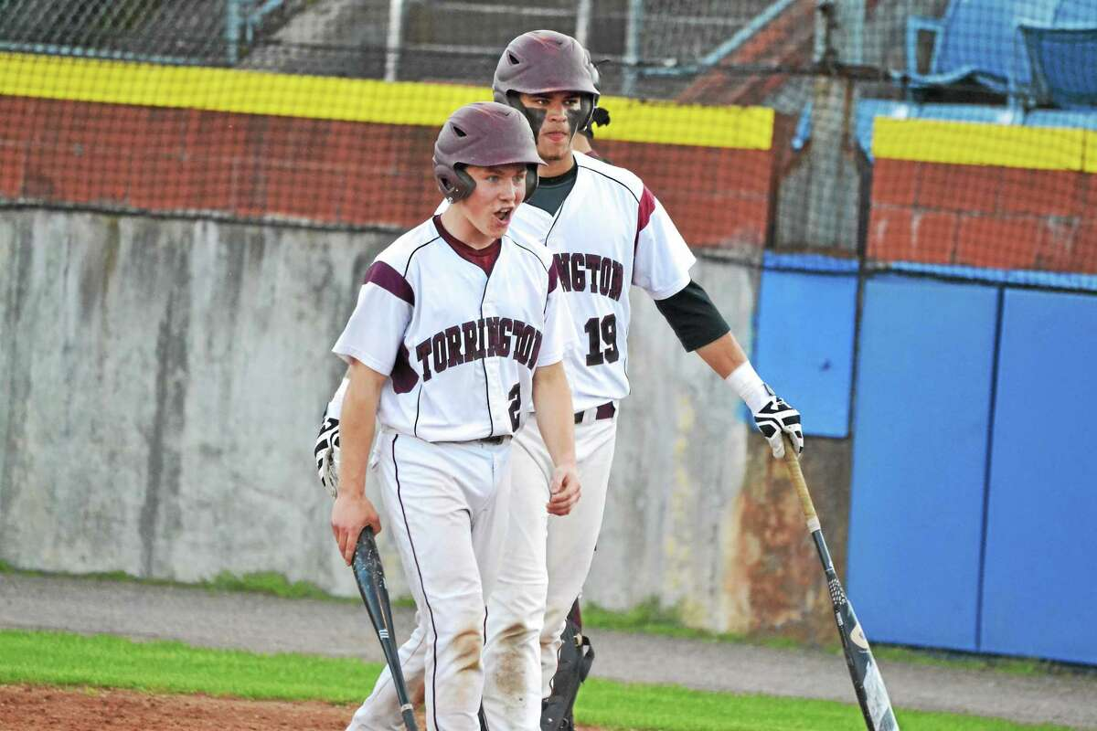 Torrington's Ben Thompson celebrates after scoring on a John McCarthy base hit in the Red Raider's 11-5 win over Naugatuck. Thompson had two doubles and three RBI.