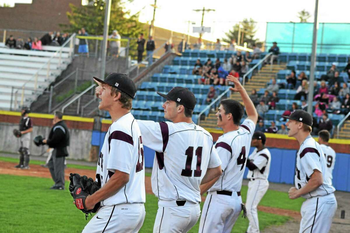 Torrington's Nate Manchester, Shane Bierfeldt, John McCarthy and Jason Vinisko cheer from the dugout after Manny Rijo doubled home Mitch Zagrodnick in the third inning.