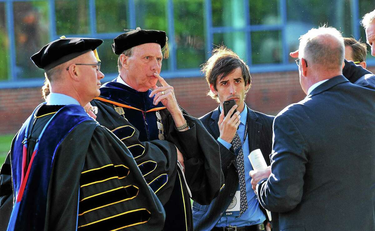 Quinnipiac University President John Lahey, second from left, talks with police and security officials moments before deciding to move the graduation ceremony from the main campus to the TD Bank Arena because of 'multiple security threats.' 5/18/14 pcasolino@newhavenregister.com