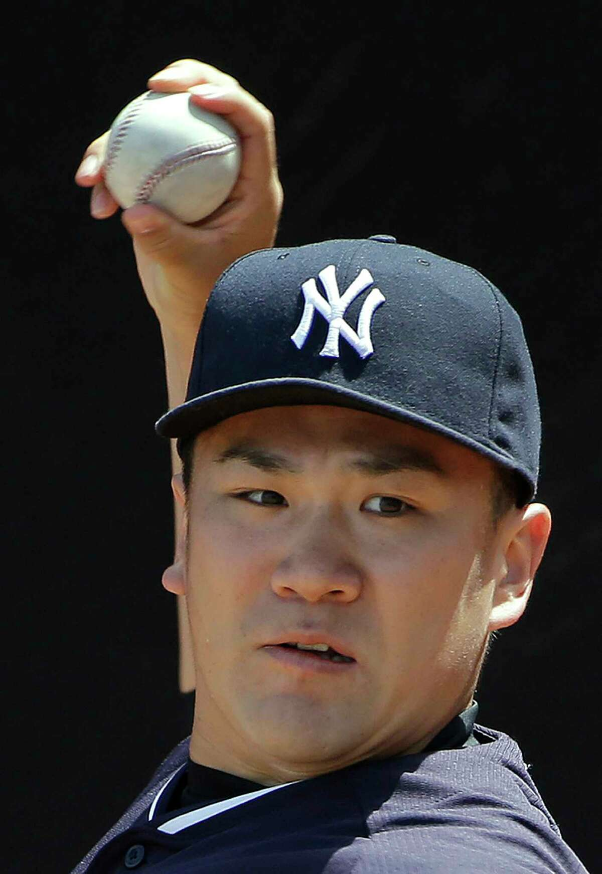 Yankees pitcher Masahiro Tanaka warms up in the bullpen before throwing a simulated game Monday.