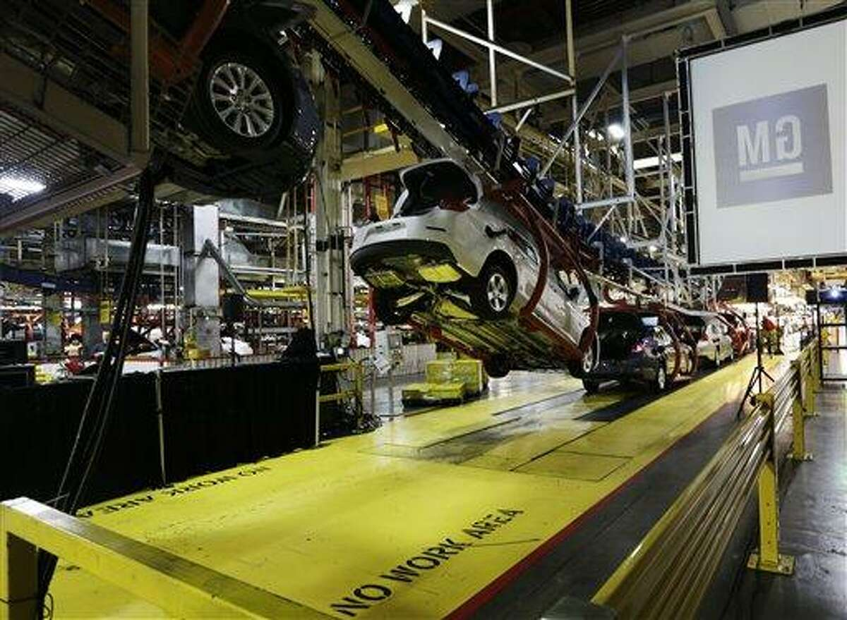 In this Monday, Jan. 28, 2013 file photo, cars move along an assembly line at the General Motors Fairfax plant in Kansas City, Kan. AP Photo/Orlin Wagner