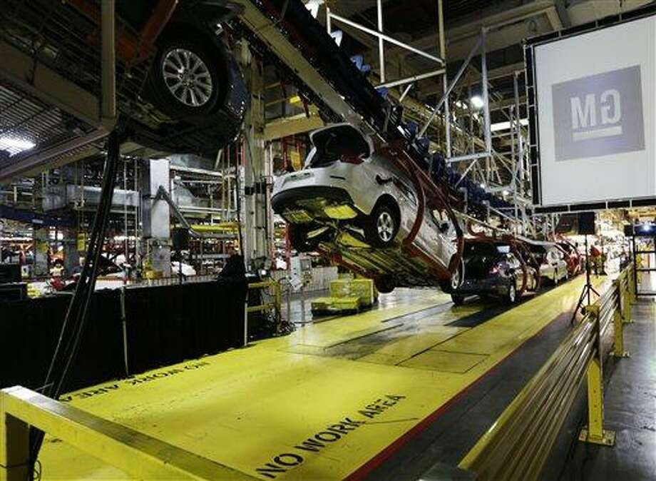 In this Monday, Jan. 28, 2013 file photo, cars move along an assembly line at the General Motors Fairfax plant in Kansas City, Kan. AP Photo/Orlin Wagner Photo: AP / AP