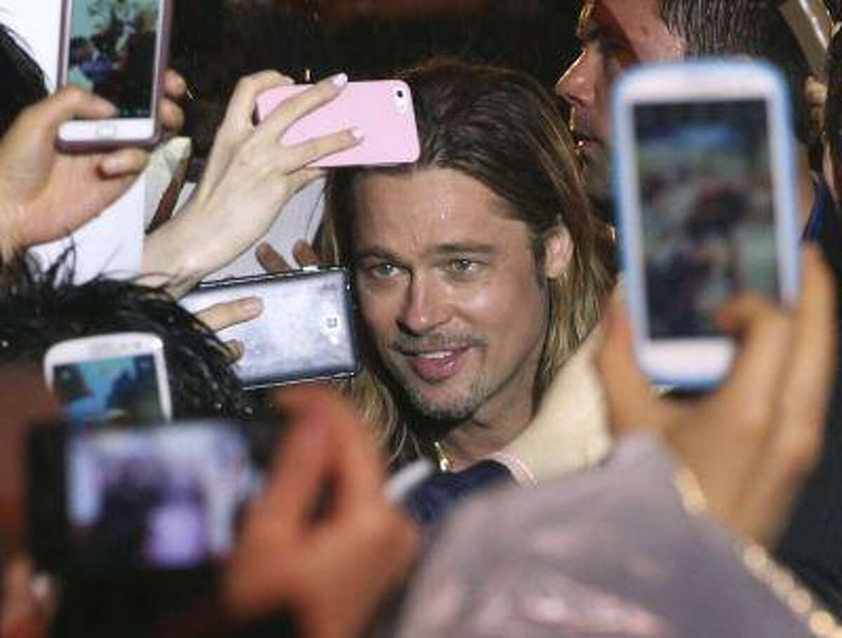 U.S. actor Brad Pitt is greeted by fans during the South Korea premiere of his latest film
