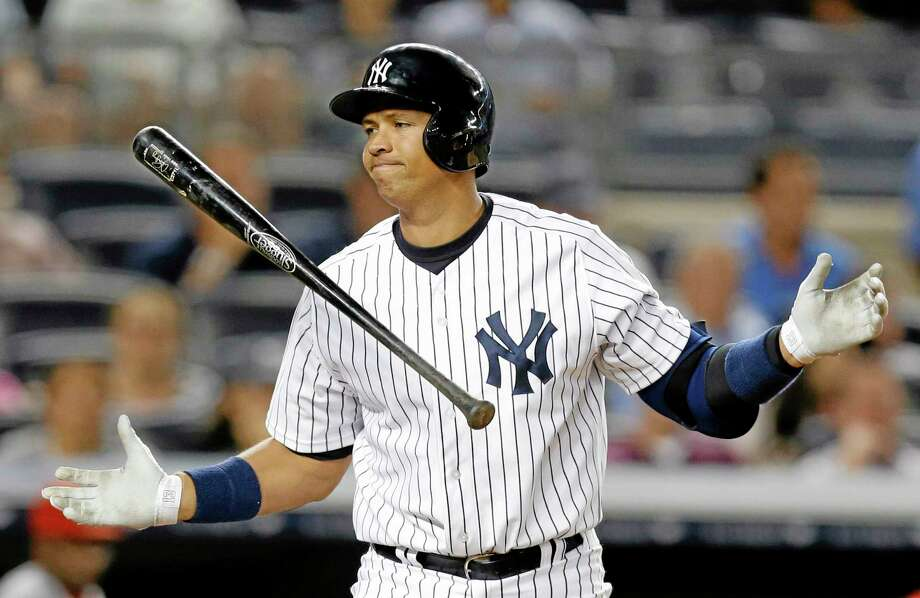 In this Aug. 13, 2013 file photo, New York Yankees' Alex Rodriguez reacts after striking out in the seventh inning of a baseball game against the Los Angeles Angels in New York.  Rodriguez's drug suspension has been reduced to 162 games, potentially sidelining the slugger for the entire 2014 season. Photo: Kathy Willens—File—The Associated Press  / AP
