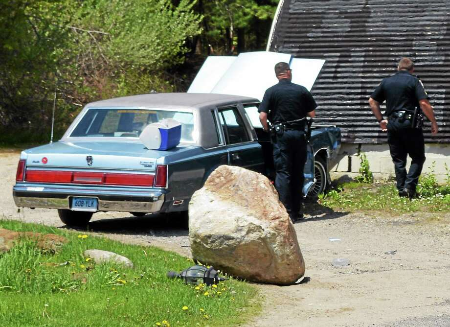 Officers process the scene of an accident at Southworth's Wayside Furniture, located at 3261 Winsted Road in Torrington, Monday afternoon. Photo: Jenny Golfin — The Register Citizen