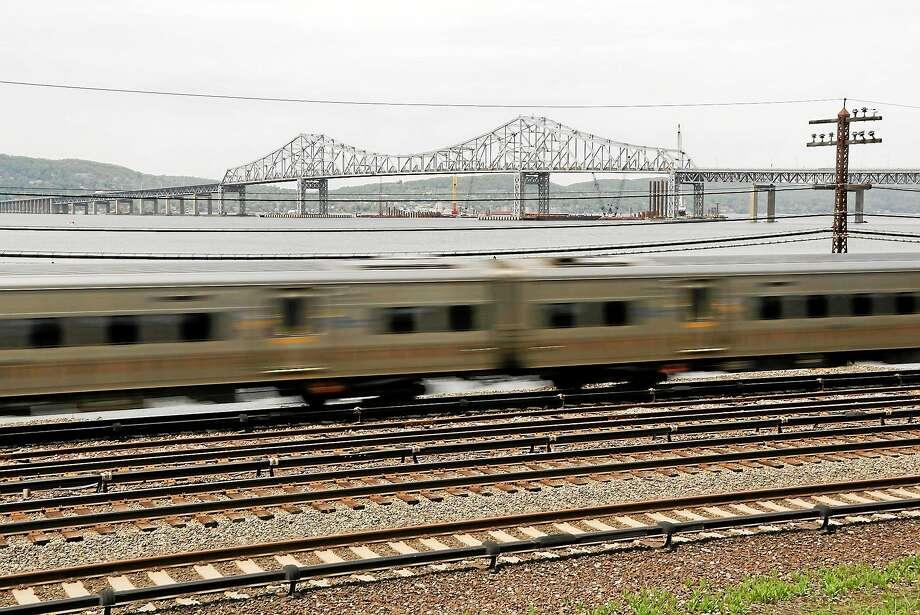 A Metro-North train streaks along the Hudson River just south of the Tappan Zee Bridge in Tarrytown, N.Y. Photo: AP Photo/Julie Jacobson  / AP