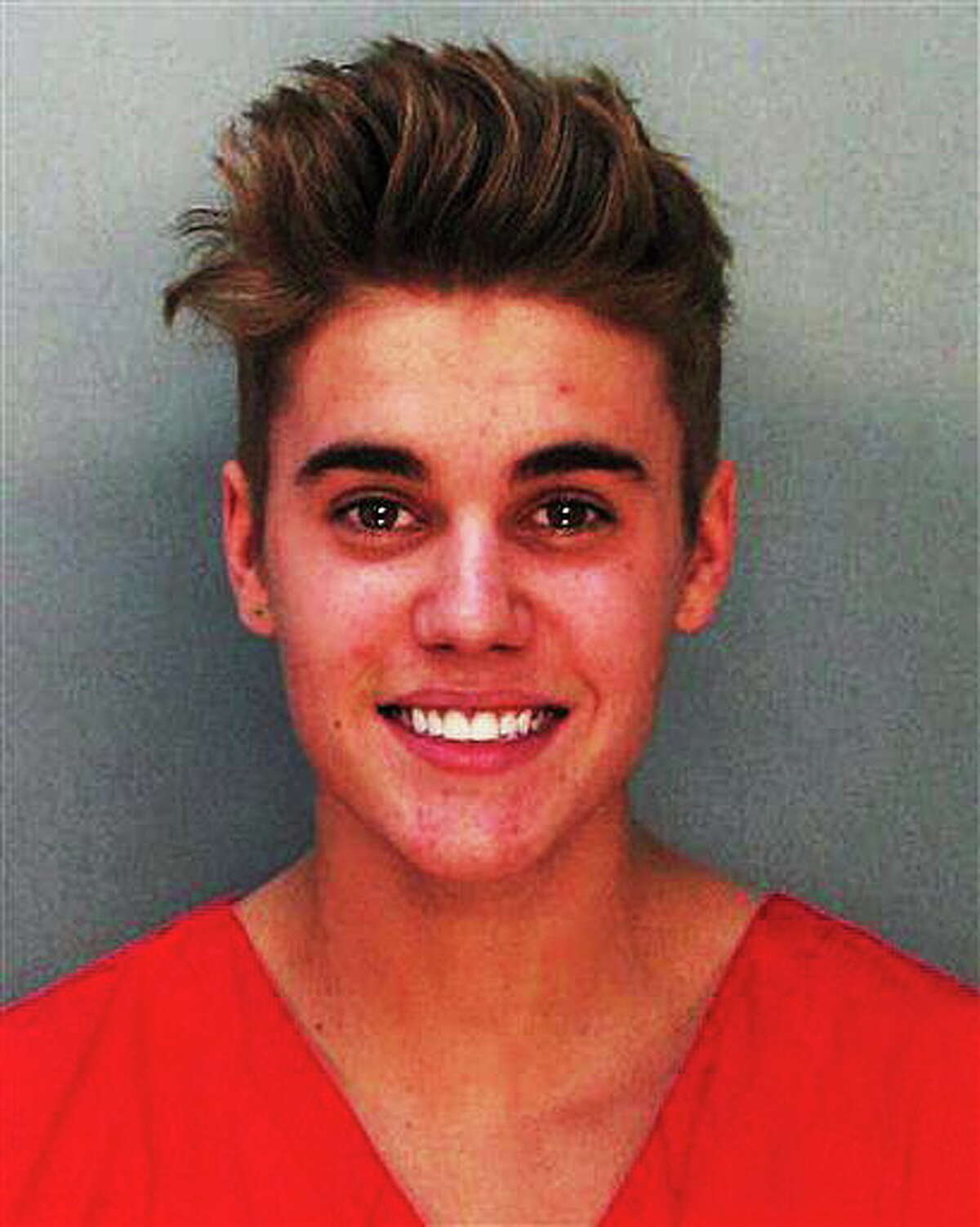 This police booking mug made available by the Miami Dade County Corrections Department shows pop star Justin Bieber, Thursday, Jan. 23, 2014. Bieber and singer Khalil were arrested for allegedly drag-racing on a Miami Beach Street. Police say Bieber has been charged with resisting arrest without violence in addition to drag racing and DUI. Police also say the singer told authorities he had consumed alcohol, smoked marijuana and taken prescription drugs. (AP Photo/Miami Dade County Jail)