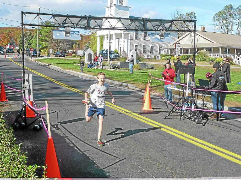 Chris Case, 13, of Burlington finished the race first overall with a time of 25:26:41. His father John came in third. Photo: Ryan Flynn - Register Citizen