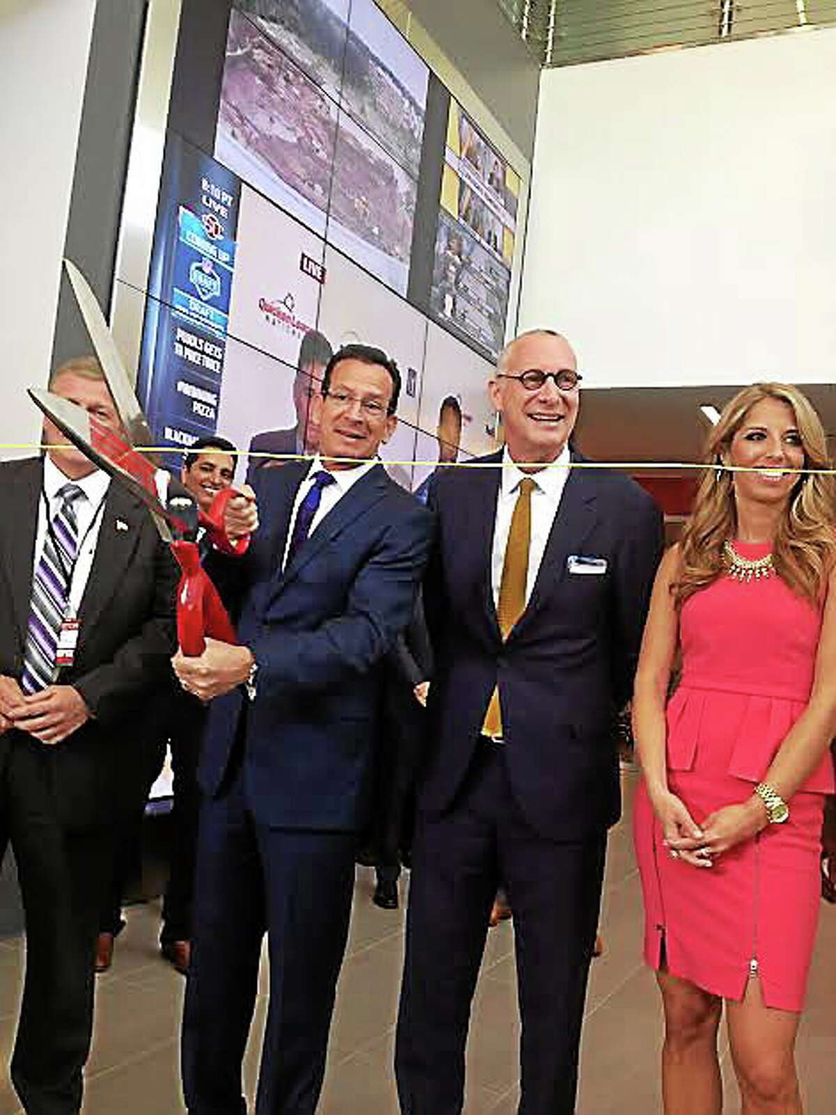 Gov Malloy and John Skipper, president of ESPN cut cable to open new Digital Center 2