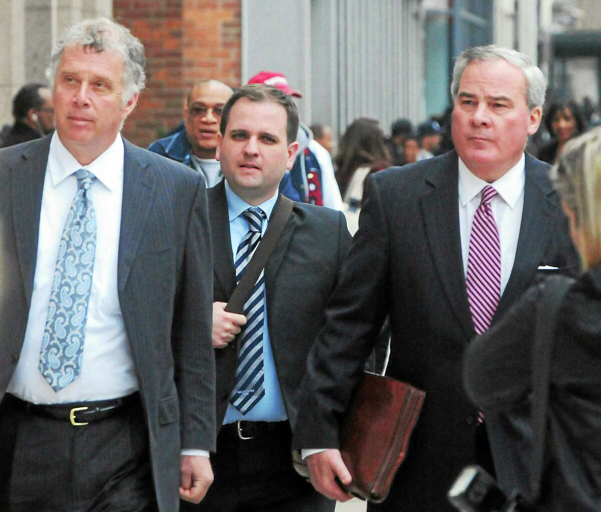 Former Connecticut Governor John G. Rowland, right, arrives with his attorney Reid Weingarten, far left, at the Federal Courthouse in New Haven Friday afternoon, April 11, 2014.