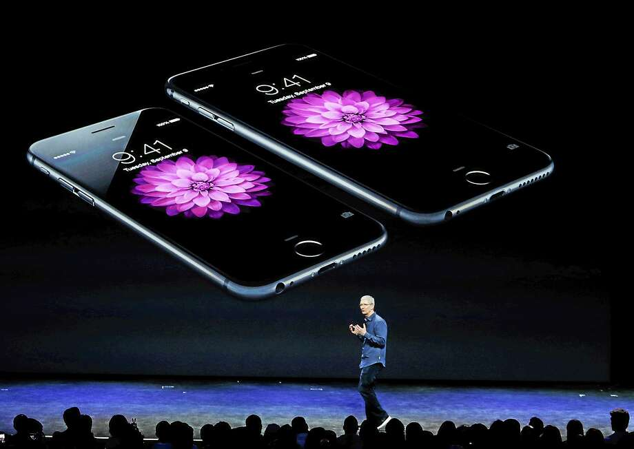 Apple CEO Tim Cook introduces the iPhone 6 on Sept. 9, 2014, in Cupertino, Calif. Photo: AP Photo/Marcio Jose Sanchez  / AP