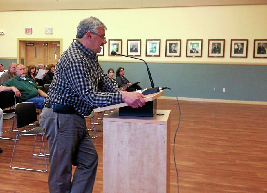 Water Pollution Control Authority Administrator Ray Drew addresses the WPCA Monday in Torrington during a public hearing. Drew suggested increasing the current sewage user rates by $6, which the WPCA approved unanimously. Photo: Esteban L. Hernandez — The Register Citizen
