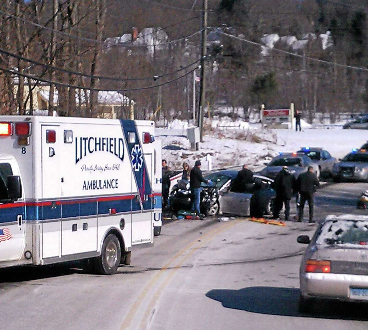 Emergency responders at the scene of a car crash on Route 202 in Litchfield Thursday.