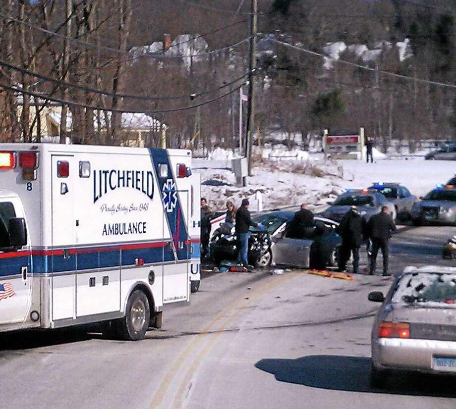 Emergency responders at the scene of a car crash on Route 202 in Litchfield Thursday. Photo: Emily Olsen—Register Citizen