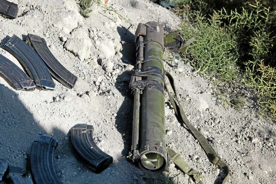 In this photo released by the Syrian official news agency SANA, destroyed weapons and ammunitions carried by Syrian rebels like at the site after they were killed by Syrian government forces according to SANA, near the Otaiba area, near Damascus, Syria, Friday, Oct. 25, 2013. Syrian government troops on Friday ambushed rebels near the capital, Damascus, killing at least 40 opposition fighters, state media reported. The ambush was part of the military's offensive against rebel strongholds around President Bashar Assad's seat of power. (AP Photo/SANA) Photo: AP / SANA