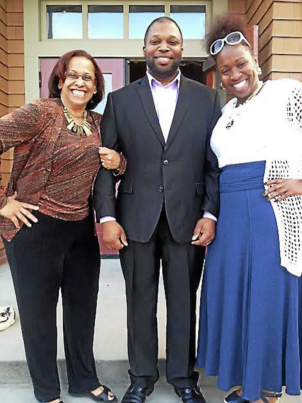 State Sen Gary Holder-Winfield, D10th, center was nominating for 2nd term in Senate Monday. At left is state Rep. Toni Walker with state Rep. Robyn Porter, right.