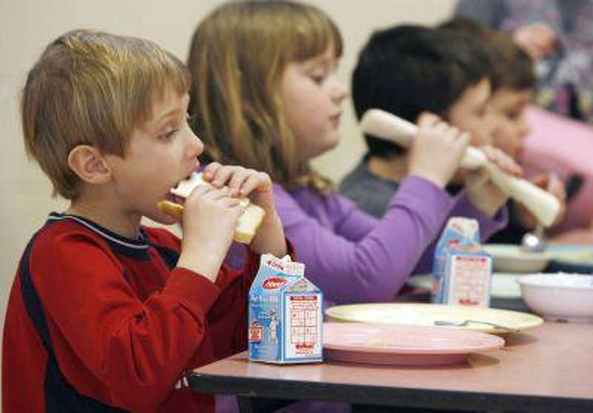 In this Feb. 3, 2010 file photo, students eat lunch at Sharon Elementary School in Sharon, Vt. Vermont ranks second in the country in an annual report of kids' well-being. The Annie E. Casey Foundation's Kids Count report released Monday shows improvements in eight areas like in the percentage of children with health insurance and fewer teen births but poverty continues to be a problem. Vermont fell slightly in the percentage of children with parents who lack secure employment to 29 percent. New Hampshire was the top-ranked state, followed by Vermont and Massachusetts. Nevada, Mississippi and New Mexico took the bottom three spots. Overall, Vermont ranked third in the country in education and family and community and fourth in health. (AP Photo/Toby Talbot)