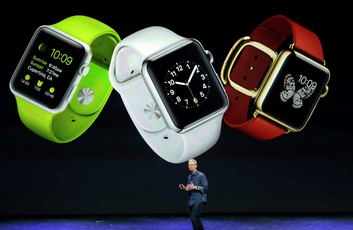 Apple CEO Tim Cook discusses the new Apple Watch in Cupertino, Calif., on Tuesday.
