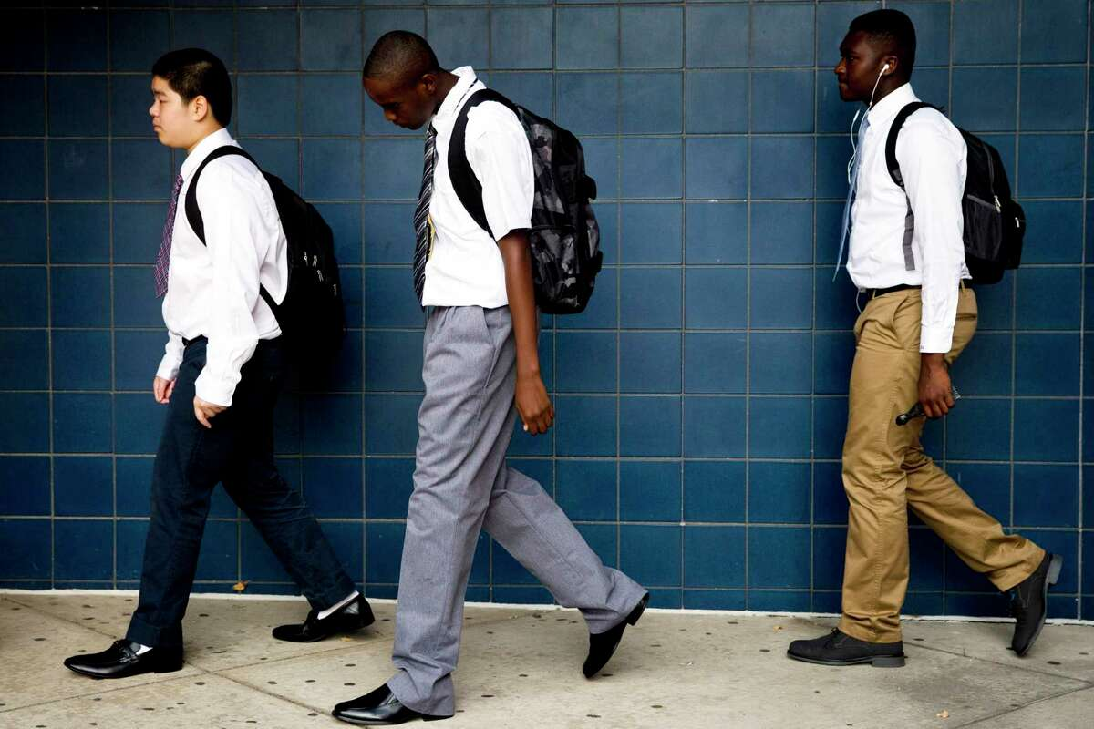 Students arrive at the new high school called The LINC, which stands for Learning in New Contexts Monday, Sept. 8, 2014, in Philadelphia. Philadelphia opened three new public high schools Monday in an effort to show the troubled district is still trying to innovate despite the specter of massive layoffs. (AP Photo/Matt Rourke)