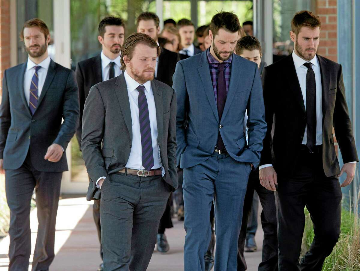 Rangers players leave a funeral home following service's for the mother of teammate Martin St. Louis on Sunday in Laval, Quebec.