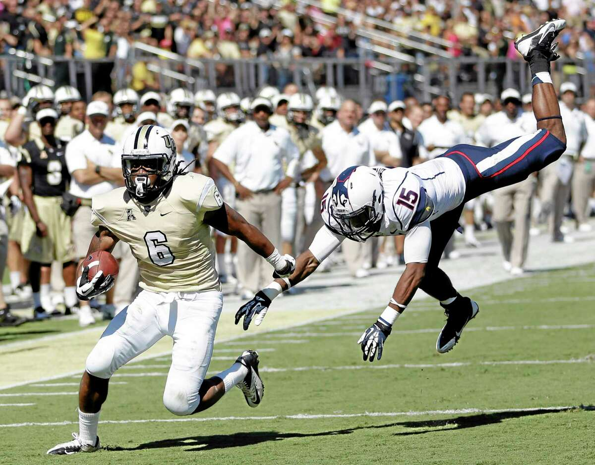 Central Florida wide receiver Rannell Hall runs for a 17-yard touchdown past UConn safety Ty-Meer Brown during the first half Saturday in Orlando, Fla.