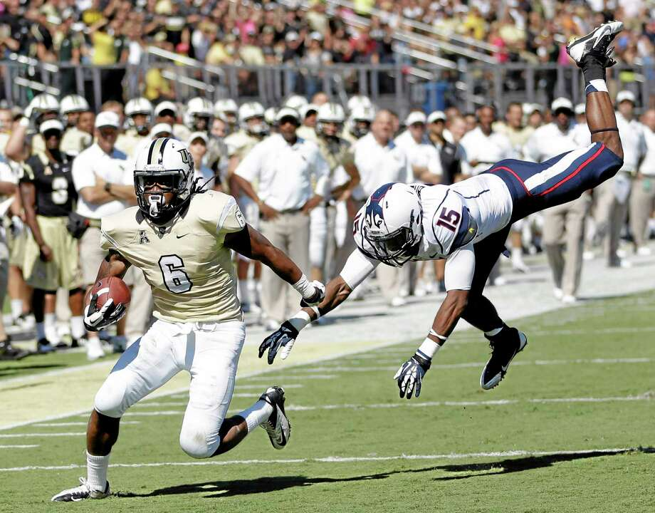 Central Florida wide receiver Rannell Hall runs for a 17-yard touchdown past UConn safety Ty-Meer Brown during the first half Saturday in Orlando, Fla. Photo: John Raoux — The Associated Press  / AP