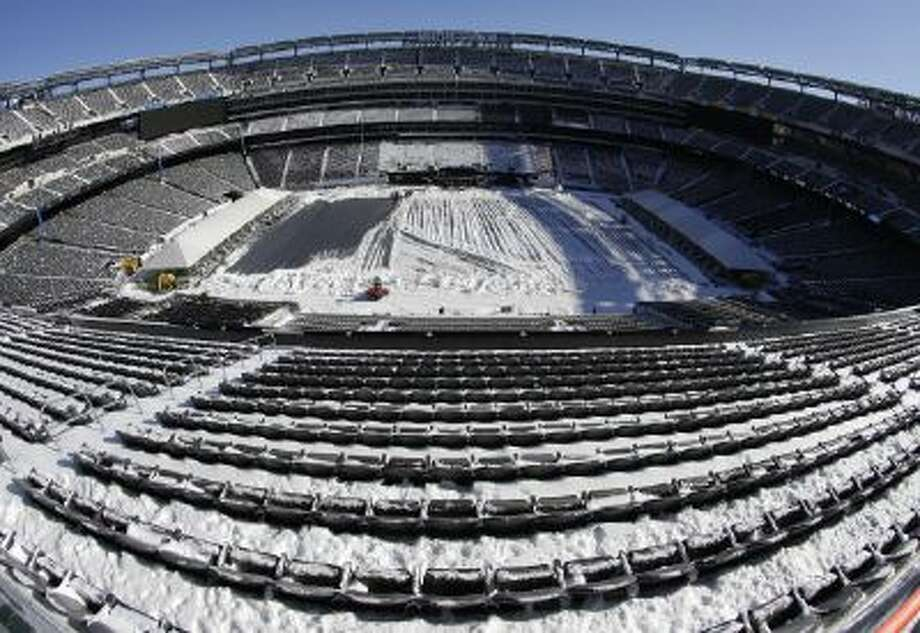 Snow is accumulated on the seats and on the field of MetLife Stadium Wednesday, in East Rutherford, N.J.