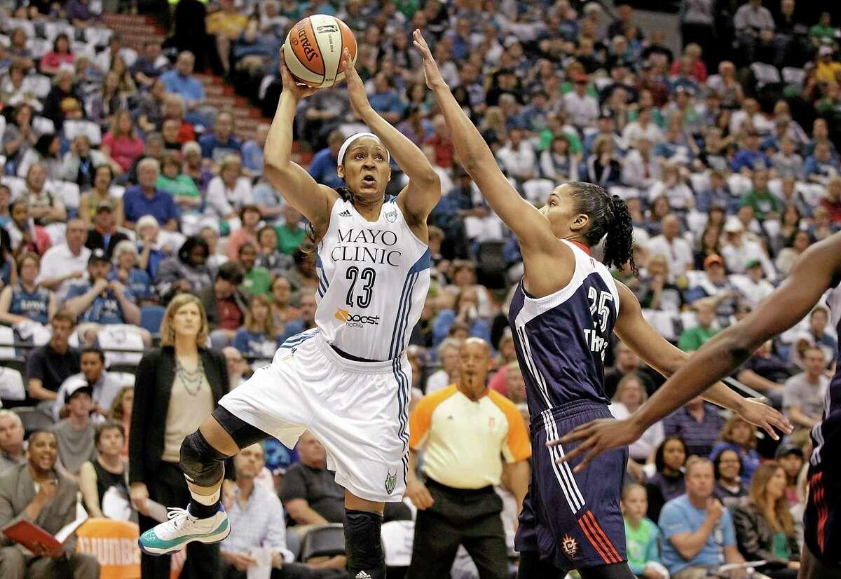 Minnesota Lynx forward Maya Moore (23) looks to shoot the ball against Connecticut Sun forward Alyssa Thomas (25) in the first half Sunday.
