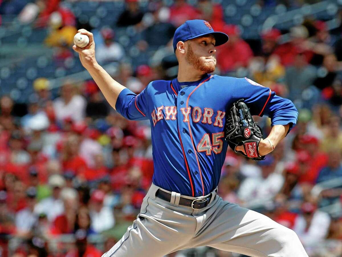 New York Mets starting pitcher Zack Wheeler throws during the third inning Sunday.