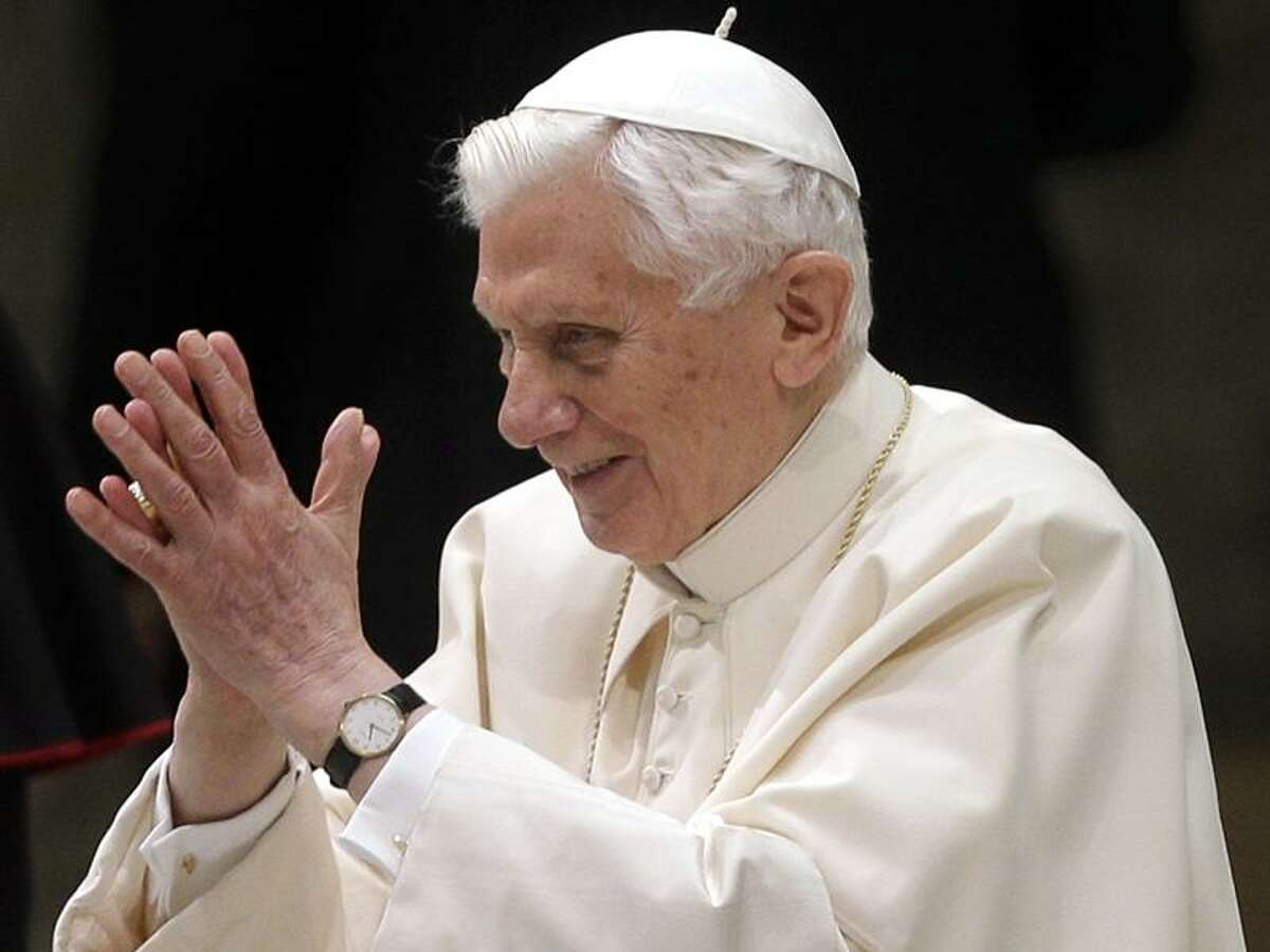 Pope Benedict XVI arrives for his weekly general audience at the Paul VI Hall at the Vatican, Wednesday Feb. 13, 2013. Pope Benedict XVI is telling the faithful in his first public appearance since announcing his resignation that he stepping down for