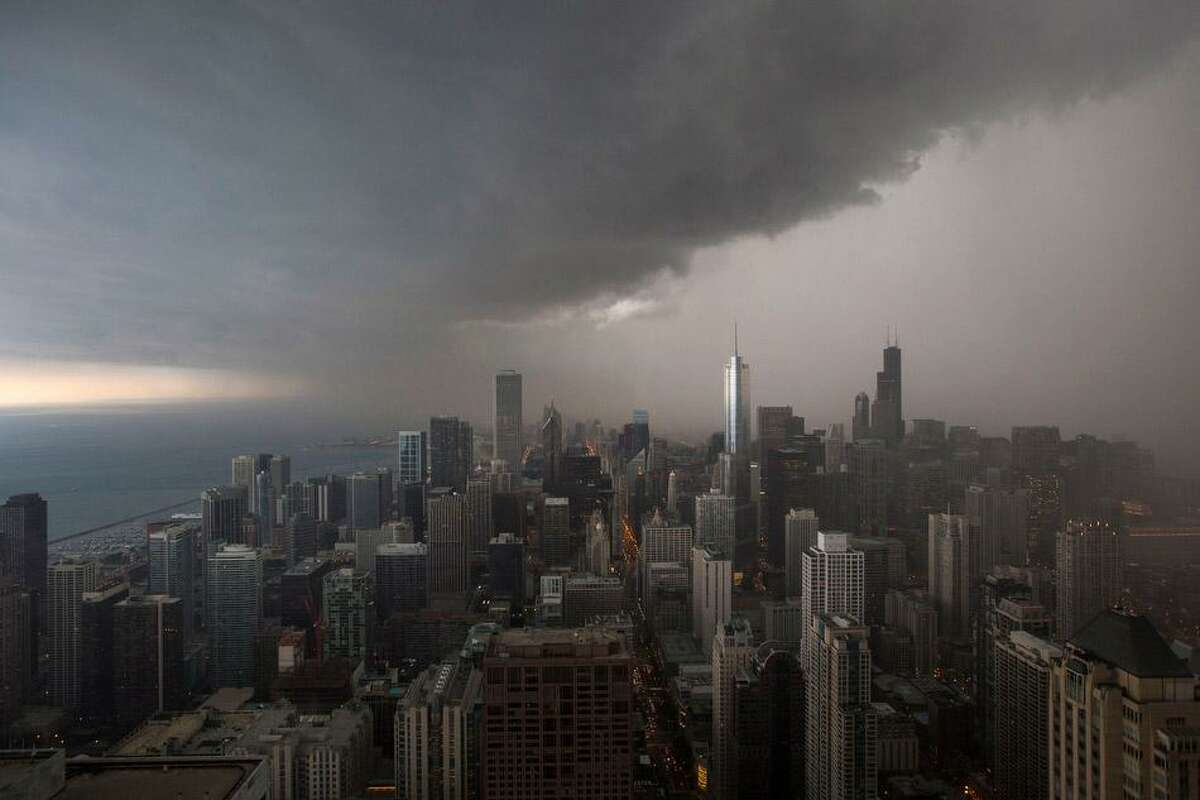 A thunderstorm with heavy rains approaches downtown Chicago, Monday, June 24, 2013. (AP Photo/Scott Eisen)