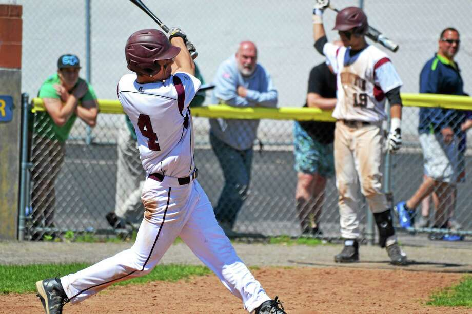 Torrington's John McCarthy hits one of his two doubles in the Red Raiders' 9-1 win over Northwestern. McCarthy went 5-for-5 with two doubles, two runs scored and four RBI. Photo: Pete Paguaga — Register Citizen