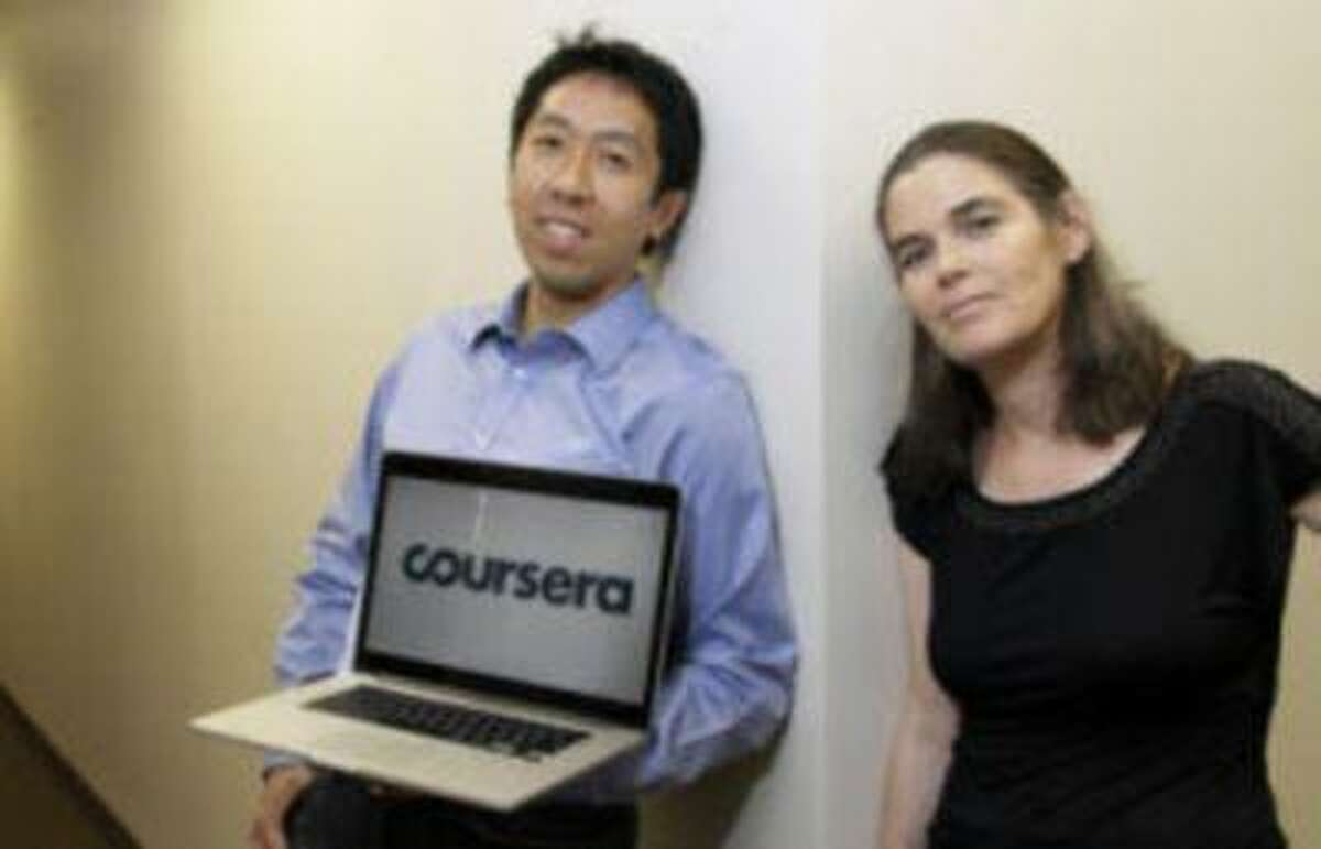 In this Aug. 2, 2012 photo, Andrew Ng and Daphne Koller, Stanford University computer science professors who started Coursera, pose for a photo at the Coursera office in Mountain View, Calif. This month Coursera announced that a dozen top research campuses have joined Stanford and Princeton universities in offering online courses through its online platform. (AP Photo/Jeff Chiu)