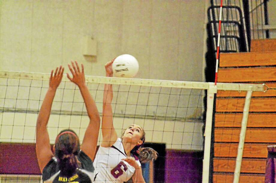 Torrington's Carissa Carbone spikes on of her six kills in Torrington's quarter-finals 3-1 win over Holy Cross. Photo: Pete Paguaga — Register Citizen