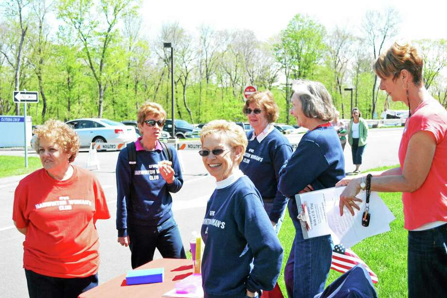 Ryan Flynn - Register Citizen The Harwinton Women's Club were among the civic groups and vendors with tables set up on the green near town hall. Photo: Journal Register Co.