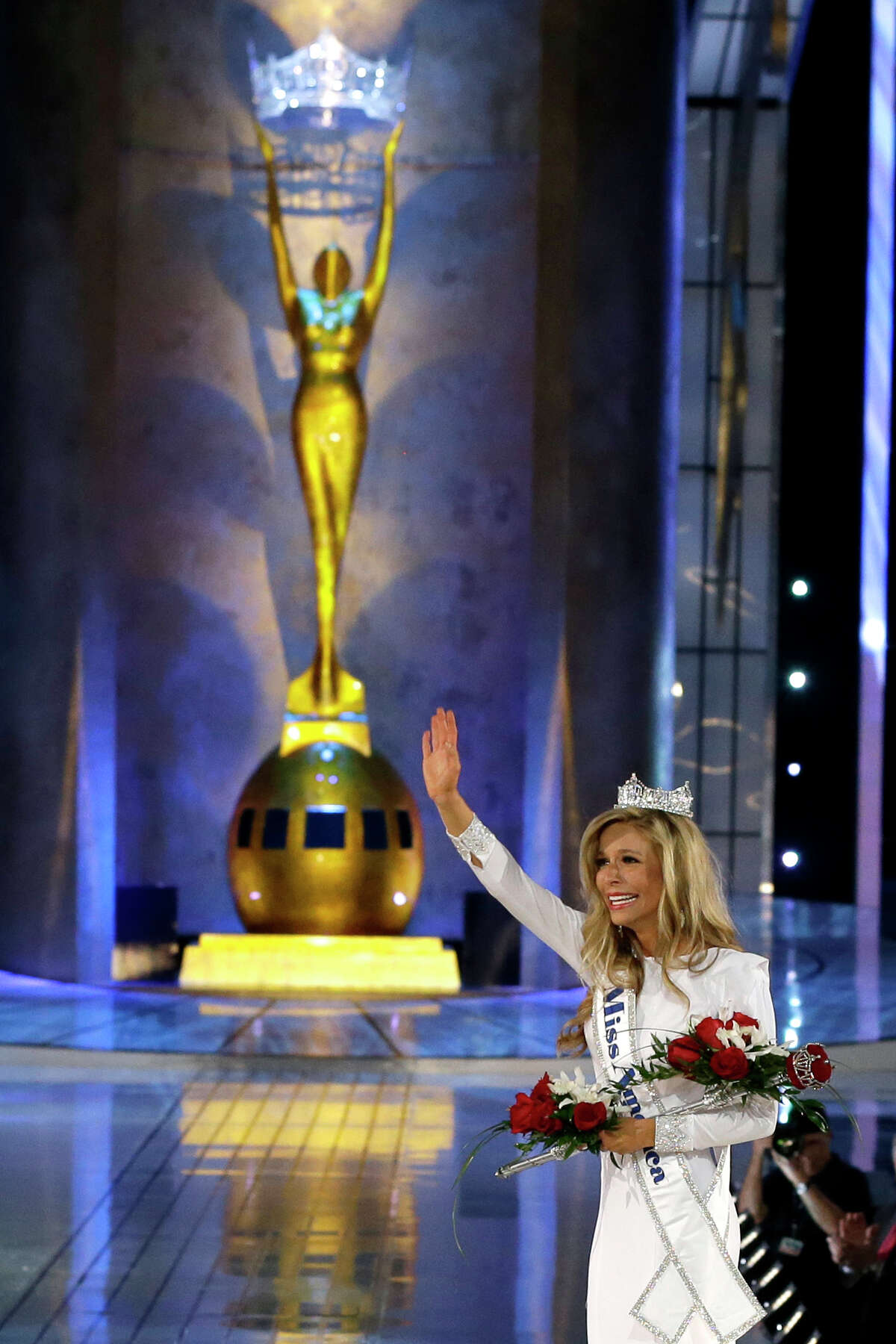 Miss New York Kira Kazantsev waves after being crowned Miss America 2015 during the Miss America 2015 pageant, Sunday, Sept. 14, 2014, in Atlantic City, N.J.