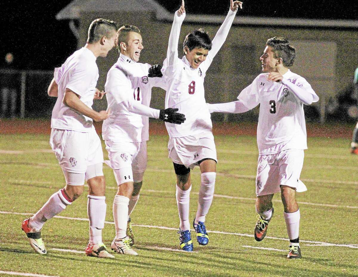 Marianne Killackey - Special to Register CitizenTorrington's Kevin Vaca celebrates a goal with teammates. The Red Raiders defeated Wilby 5-0.