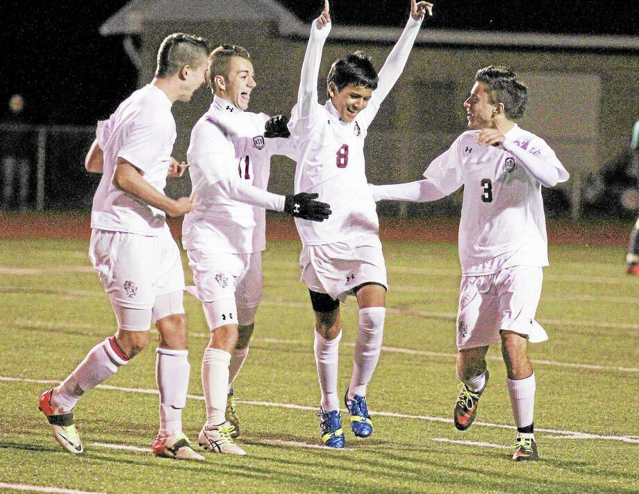 Marianne Killackey - Special to Register CitizenTorrington's Kevin Vaca celebrates a goal with teammates. The Red Raiders defeated Wilby 5-0. Photo: Journal Register Co. / 2013