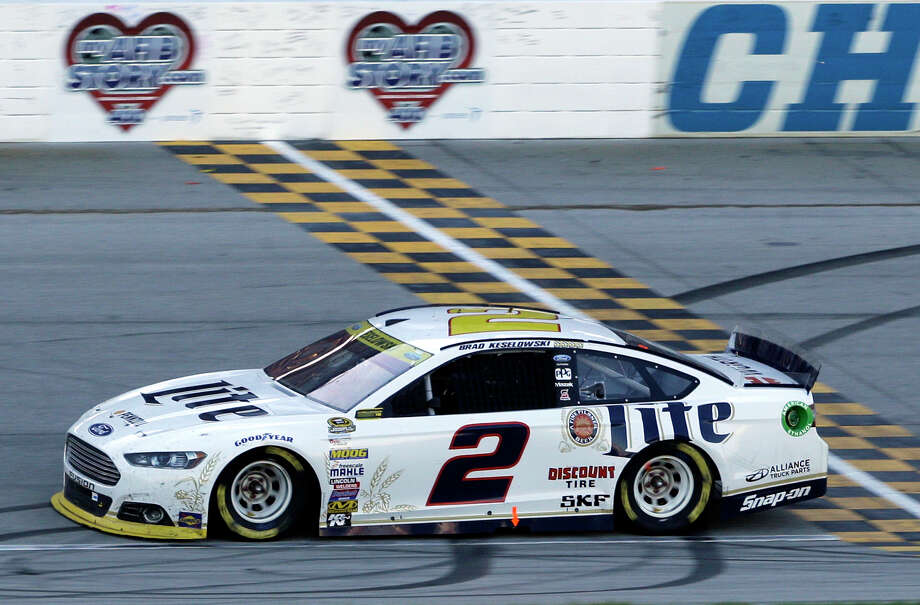Brad Keselowski crosses the finish line as he wins the NASCAR Sprint Cup series race at Chicagoland Speedway on Sunday. Photo: Nam Y. Huh — The Associated Press  / AP