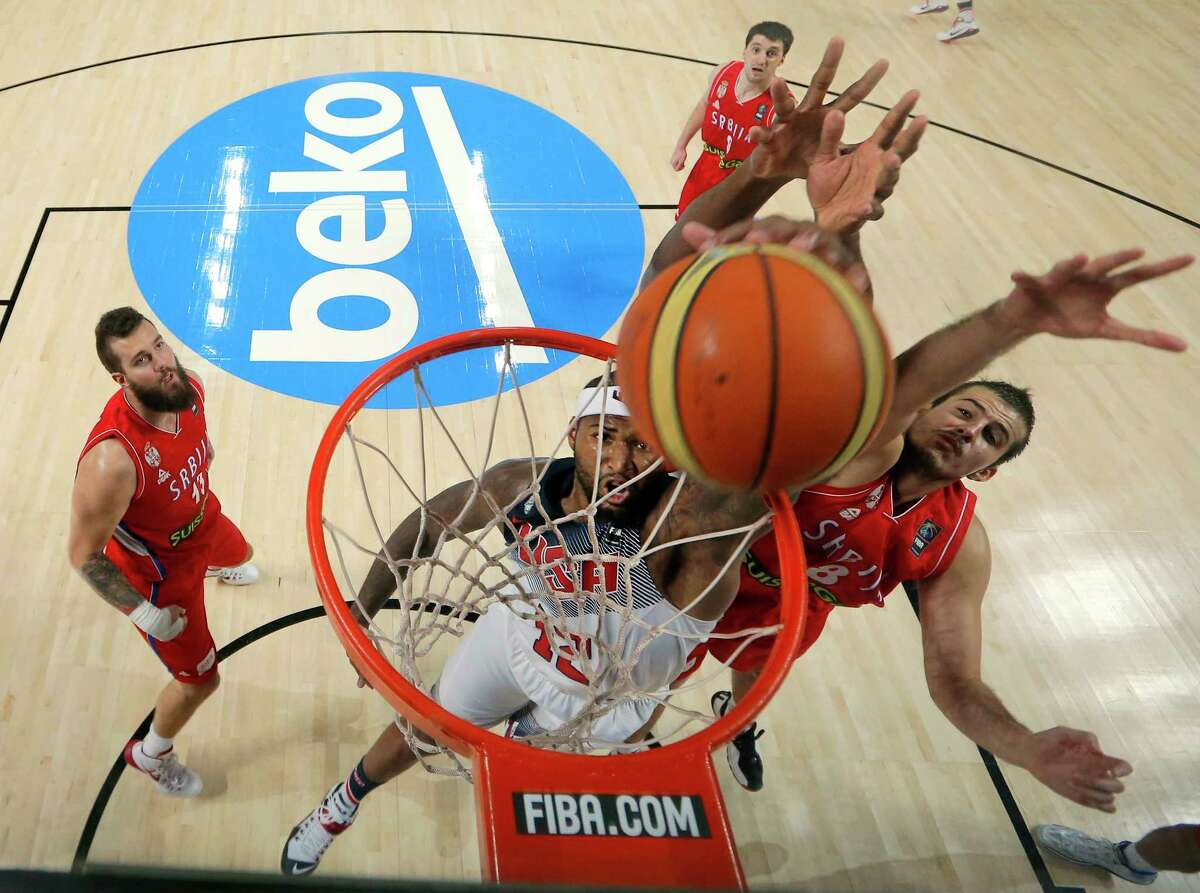 DeMarcus Cousins, center, dunks during the championship game of the Basketball World Cup against Serbia on Sunday.