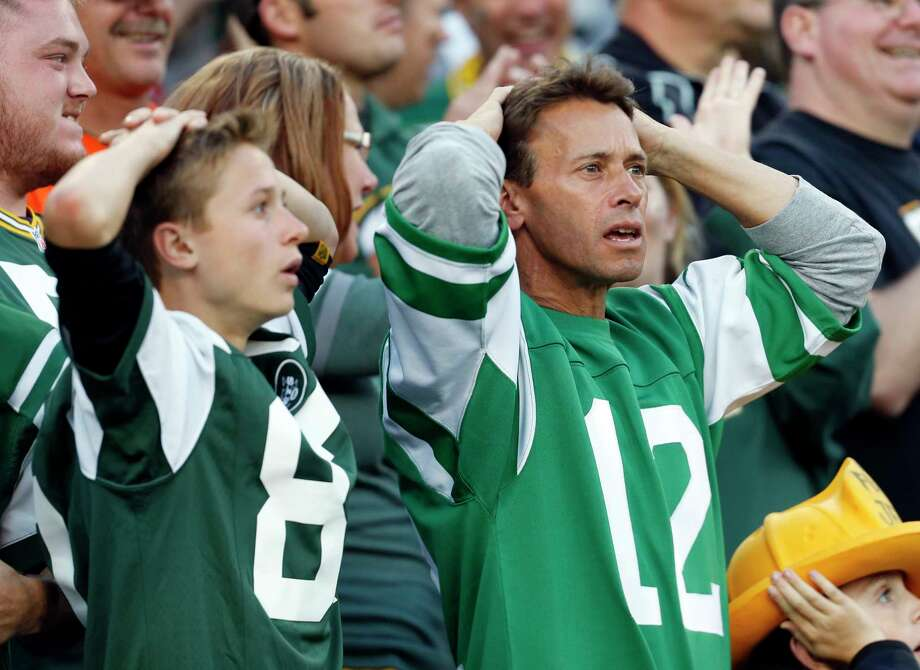 Jets fans react after a touchdown catch was called back because the team called a timeout before the ball was snapped in the fourth quarter on Sunday. Photo: Mike Roemer — The Associated Press  / FR155603 AP