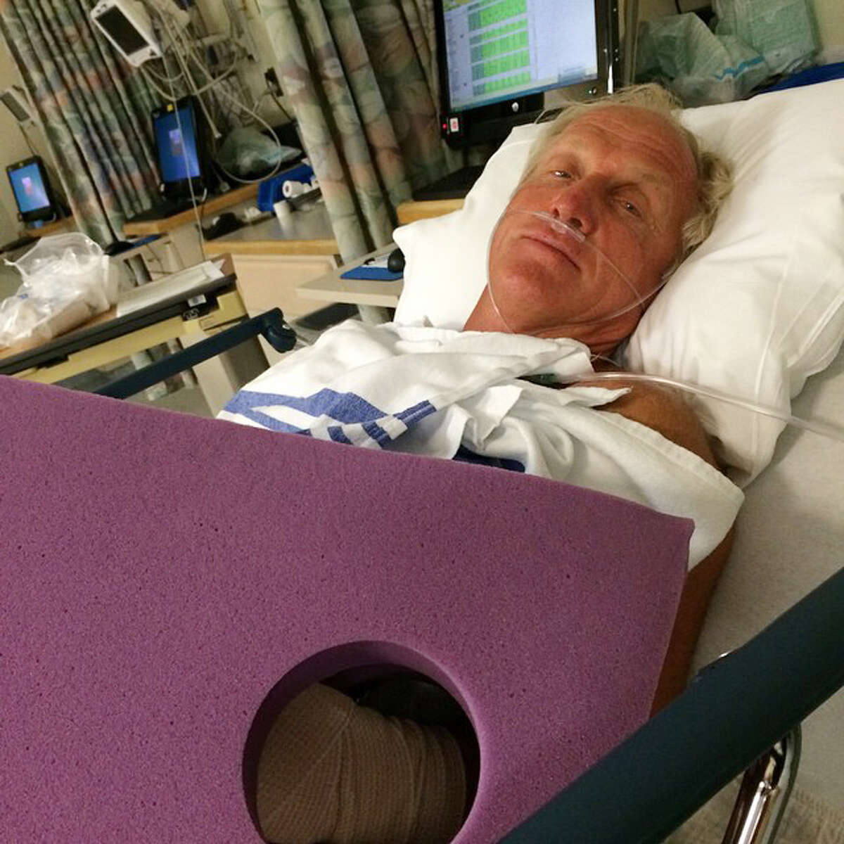 This photo provided by Greg Norman shows Norman resting in a hospital bed after a chainsaw accident.
